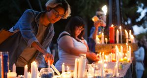 People light candles to add to a growing memorial outside of Cal Anderson Park to honour the Orlando shooting victims in Seattle on Sunday, June 12th, 2016. Photograph: Lindsey Wasson/The Seattle Times via AP