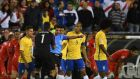 Brazil players argue with Uruguayan referee Andres Cunha as he consults his assistants before awarding a goal to Peru. Brazil have failed to get out of their Copa America group for the first time since 1987. Photograph: Getty Images