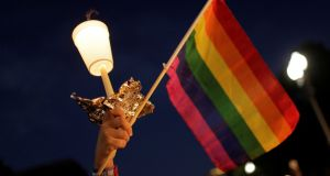A rainbow flag held aloft during a vigil after the worst mass shooting in US history at a gay nightclub in Orlando, Florida. Photograph: Joshua Roberts/Reuters