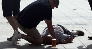 An England supporter lies unconscious on the ground after clashing with Russian fans in Marseille. Photograph: Carl Court/Getty Images