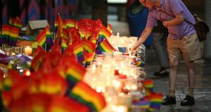 'LGBT people will inevitably respond how they always have in the face of violence and homophobia; with love, by gathering together, by saying: we are family.' A man looks over an impromptu candle-lit memorial set up in Sydney, Monday, June 13, 2016. Photograph: AP Photo/Rick Rycroft.