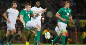 Paddy Jackson puts boot to ball against South Africa in Cape Town. Photograph: Getty Images