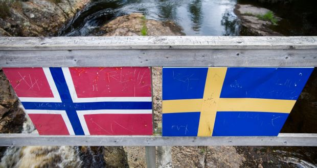 Close sweden norway ties despite eu border dividing them a footbridge straddling the swedish norway border photograph mikael hjerpeistockphoto platinumwayz