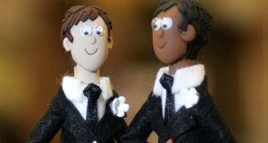 A wedding cake figurine of a couple made up of two men at  Gay Wedding show. REUTERS/Ian Hodgson/Files