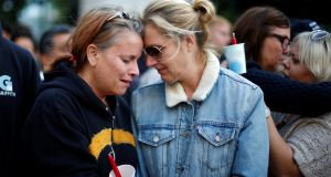 Adele Hoppe-House, 49, (L) and her wife Jennifer Hoppe-House, 52, attend a vigil in memory of victims one day after a mass shooting at the Pulse gay night club in Orlando; in Los Angeles, California, on Monday. Photograph:  Lucy Nicholson/Reuters