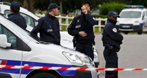Policemen at a roadblock at the scene where a French police commander was stabbed to death in front of his home in the Paris suburb of Magnanville. Photograph: Christian Hartmann/Reuters.