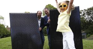 David Maguire, chairman of the Irish Solar Energy Association (ISEA) and ISEA member Peter Duff with Charlotte Maguire (age 7), from Dublin