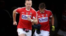 Cork players, led by Paul Kerrigan,  take to the field in Semple Stadium, Thurles. Photograph: Ryan Byrne/Inpho