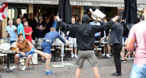 A Russian football supporter lobs a chair towards Slovakian fans sitting in a cafe in the northern city of Lille on June 14th. Photograph: Leon Neal/AFP/Getty Images
