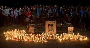 Young mourners, many J1 students, attend a candlelight vigil in Berkeley the night after the Irish students were killed when a balcony in an apartment collapsed during a party. Photograph: Beck Diefenbach/AP Photo