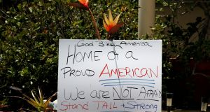 A sign  in front of a house across the street from Omar Mateen's home in Port Saint Lucie, Florida, US. Photograph: Carlo Allegri/Reuters