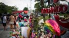 People pray near a makeshift memorial for the victims of the Pulse Nightclub shooting outside of Orlando Regional Medical Center Orlando, Florida, USA, 14th June 2016. Photograph: John Taggart/EPA