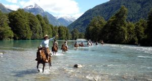 River crossing on horseback in the Andes