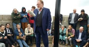 Actor Owen Roe reading from Ulysses at the top of the Joyce Tower in Sandycove Co Dublin on Thursday morning as part of Bloomsday celebrations. Photograph: Frank Miller/The Irish Times