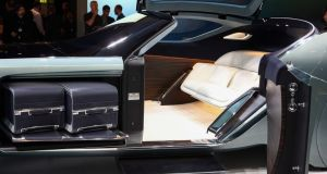 Suitcases sit inside a luggage compartment in the Rolls-Royce Vision Next 100 concept.