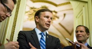 Democratic senator Chris Murphy  speaks to reporters after waging an almost 15-hour filibuster on the US Senate floor in order to force a vote on gun control. Photograph:  Pete Marovich/Getty Images