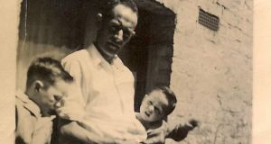 Thom Hickey with his father Wally and younger brother Gerry in their back yard in Church Street, Paddington, London in the late 1950s