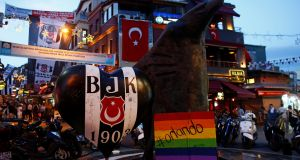 A rainbow placard in memory of the victims of the massacre at the Pulse nightclub in Orlando, Florida,  last weekend  is placed under an eagle statue, symbol of Besiktas Sports Club, in  the Besiktas district of Istanbul, Turkey, this week. File photograph: Murad Sezer/Reuters