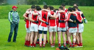 Half-time huddle:  Cuala GAA senior footballers talk tactics. Photograph: Dave Meehan