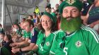 Kate Turner and her brother Justin, who was declared official fan of the match during Northern Ireland's 2-0 victory over Ukraine. Photograph: Gerry Moriarty.