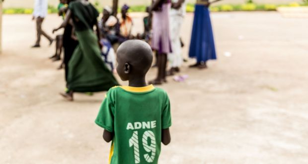 A child stands by a group of people in Gambella, Ethiopia. Photograph: Unicef Ethiopia/AFP/Getty Images