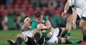 Ireland's Craig Gilroy is tackled by  Francois Louw. Photo: Billy Stickland/Inpho