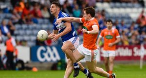 Laois' Colm Begley is challenged by and Charlie Vernon of Armagh during the  All-Ireland  SFC Round 1A Qualifier at O'Moore Park in Portlaoise. Photograph: Tom Beary/Inpho