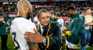 South Africa coach Allister Coetzee congratulates  Lionel Mapoe after the second Test victory over Ireland  at Ellis Park in Johannesburg. Photograph:  Sydney Seshibedi/Gallo Images/Getty Images