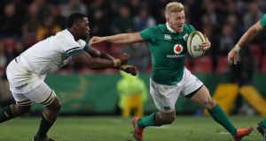 Ireland centre Stuart Olding tries to give  South Africa's Siya Kolisi the slip  during the second Test at Ellis Park in Johannesburg. Photograph: Billy Stickland/Inpho