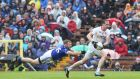 Cavan's James McEnroe dives full length to try and stop Tyrone's   Colm Cavanagh during the Ulster SFC semi-final at  St Tiernach's Park in Clones. Photograph:  Andrew Paton/Inpho/Presseye