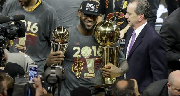 7b74de9ad4f LeBron James of the Cleveland Cavaliers holds the Larry O Brien Championship  Trophy and the