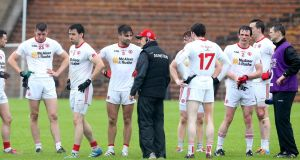 Tyrone manager Mickey Harte talks to his players after Sunday's game. Photograph: Andrew Paton/Inpho