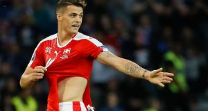 Granit Xhaka saw his shirt get ripped twice during Switerland's draw with France in Lille. Photograph: Reuters