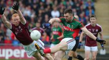 Declan Kyne tries to block down Mayo's Seamus O'Shea at MacHale Park in Castlebar, where Galway prevented their provincial rivals from continuing their quest for a sixth Connacht title in a row. Photograph: Lorraine O'Sullivan/Inpho
