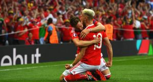 Aaron Ramsey is congratulated by  Wales team-mate James Chester  after opening the scoring in the Euro 2016 Group B game against Russia at  Stadium Municipal in Toulouse. Photograph: Stu Forster/Getty Images