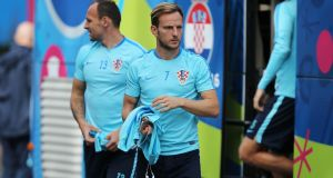 Ivan Rakitic will come up against a number of his Barcelona team mates when Croatia play Spain on Tuesday night. Photograph: Afp