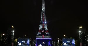 Eiffel Tower in Paris: city is among the most expensive cities in the world for expatriates to live in and work in. Photograph: Philippe Lopez/AFP/Getty Images