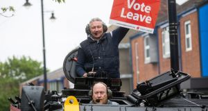 Darren Adamson, a Vote Leave campaigner, holds a Vote Leave placard as he rides in a modified FV432 armoured personnel carrier, driven by Dale McKenzie, in the Southwick district of Sunderland, earlier in June.  Photograph: Simon Dawson/Bloomberg
