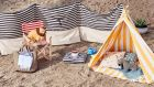 This stripe collection from German website Urbanara (0049 3046 461 987 urbanara.de) nails the nautical look and offers smart shelter options, a jolly yellow tent to protect kids from the sun, €109, and a breaker, €69, in either navy or red, for when the wind picks up. The kid-sized director's chair costs €89, a set of two floor cushions, €49 and the jute carry-all is €59.
