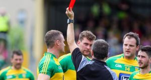 Referee Maurice Deegan sends off Donegal's Neil McGee against Fermanagh. Photograph: Lorcan Doherty/Inpho