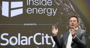 Elon Musk, chairman of SolarCity and CEO of Tesla Motors, speaks at SolarCity's Inside Energy Summit in Manhattan. photograph: rashid umar abbasi/reuters