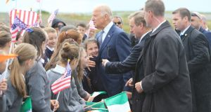 US vice-president Joe Biden is hugged by Abbie Conway from Knock, Co Mayo,   as he and Taoiseach Enda Kenny are greeted by schoolchildren from  four local schools - St Attracta's, Charlestown; Barnacogue; Tavneena and Cloonlyon, upon their arrival at Ireland West  Airport Knock. Photograph: Paul McErlane/EPA