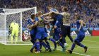 Iceland's Arnor Ingvi Traustason is mobbed by team mates after scoring their historic winner against Austria. Photograph: Reuters