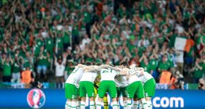 The Ireland team huddle before the game. Photo: James Crombie/Inpho