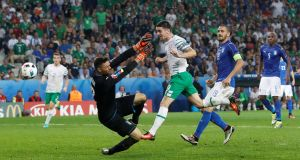 Heading to heaven: The Republic of Ireland's Robbie Brady scores against Italy in the Euro 2016 group game at Stade Pierre in Lille, France. Photograph: REUTERS/Carl RecineLivepic