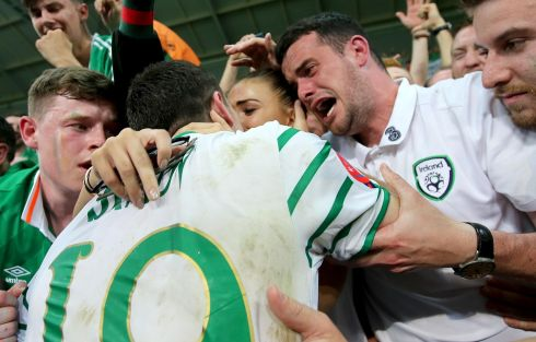 Robbie Brady celebrates with  girlfriend Kerrie Harris and his brother. Photograph: INPHO/Donall Farmer