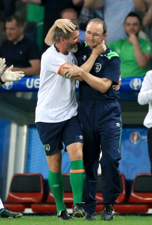 Republic of Ireland manager Martin O'Neill (right) and assistant Roy Keane celebrate qualifying for the final 16 at Euro 2016. Photograph: John Walton/PA Wire