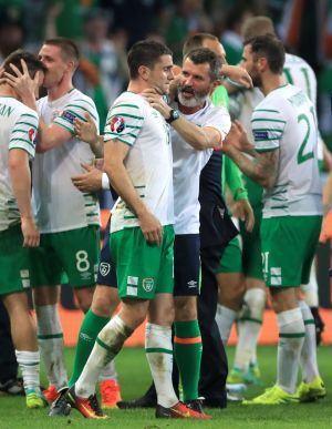 Well done, son: Robbie Brady (left) is congratulated by assistant manager Roy Keane. Photograph: John Walton/PA Wire