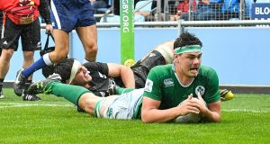 Max Deegan of Ireland scores a try for Ireland against New Zealand at the Under-20 World Championships in Manchester. Photo: Dave Howarth/Inpho