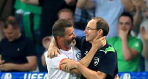 Republic of Ireland manager Martin O'Neill (right) and assistant Roy Keane celebrate qualifying for the round of 16 after the Euro 2016 Group E match at the Stade Pierre Mauroy, Lille. Photograph: John Walton/PA